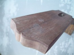 Fresh cut headstock woodgrain for broken neck repair.